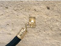 Brass wall eyelet for rope barriers